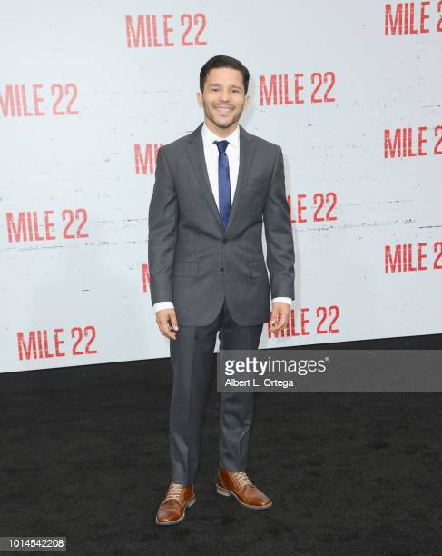 Actress Carlo Alban arrives for the Premiere Of STX Films' 'Mile 22' held at Westwood Village Theatre on August 9 2018 in Westwood California
