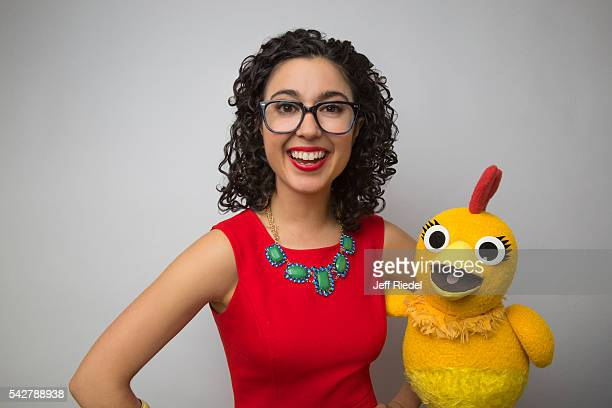 Actress Carly Ciarrocchi and Chica from Sunny Side Up are photographed for TV Guide Magazine on January 15 2015 in Pasadena California