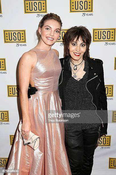 Actress Carmen Bicondova and rock musician Joan Jett attend the USO 75th Anniversary Armed Forces Gala Gold Medal Dinner at Marriott Marquis Times...