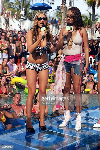 Actress Carmen Electra and MTV VJ La La appear during a taping for MTV Spring Break 2003 at the Surfcomber Hotel March 12 2003 in Miami Beach Florida