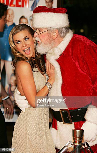 Actress Carmen Electra and Santa Claus attend the Los Angeles premiere of Cheaper By The Dozen 2 at the Mann Village Theatre on December 13 2005 in...