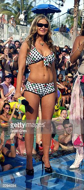 Actress Carmen Electra appears during a taping for MTV Spring Break 2003 at the Surfcomber Hotel March 12 2003 in Miami Beach Florida