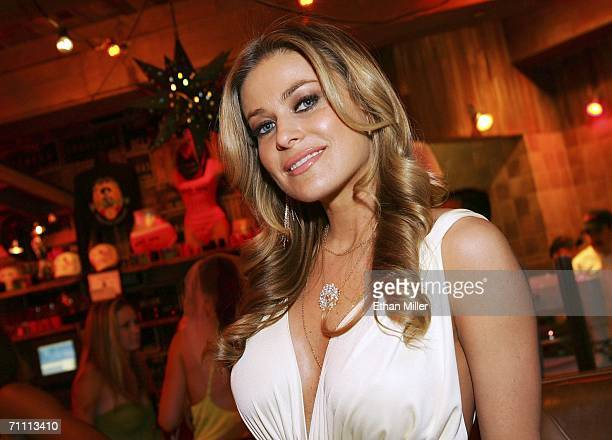 Actress Carmen Electra poses after being presented with a check for USD 50000 for her Head to Hollywood charity at the Pink Taco restaurant inside...