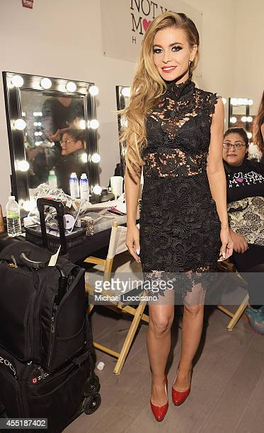 Actress Carmen Electra poses backstage during theWantmylook by Lilly Ghalichi Style360 Spring 2015 fashion show at Metropolitan Pavilion on September...