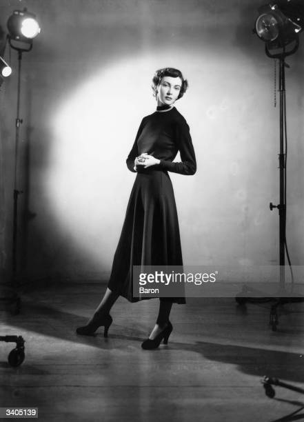 Actress Carol Anderson standing under stage lights