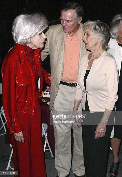 Actress Carol Channing talks to actor Peter Marshall and actress Cloris Leachman at the opening night of Carol Channing's show 'Razzle Dazzle' held...