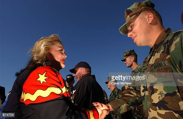 Actress Carol Conners shakes the hand of a Marine aboard the USS Ogden November 30 2001 at the 32nd Street Naval Station in San Diego CA Several...