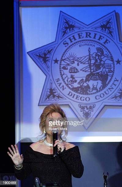Actress Carol Connors performs the national anthem at the 2nd Annual California Gold Star Awards dinner gala and auction at the Disneyland Hotel on...