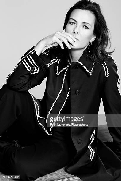 Actress Carole Bouquet is photographed for Madame Figaro on December 22 2014 in Paris France Coat and pants tshirt earings mocassins PUBLISHED IMAGE...