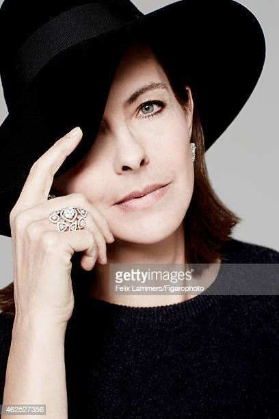 Actress Carole Bouquet is photographed for Madame Figaro on December 22 2014 in Paris France Pullover hat earrings and ring CREDIT MUST READ Felix...