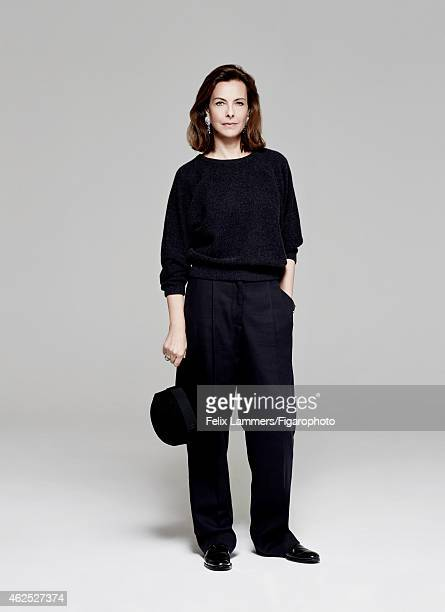 Actress Carole Bouquet is photographed for Madame Figaro on December 22, 2014 in Paris, France. Pullover , pants , hat , earrings and ring , shoes ....