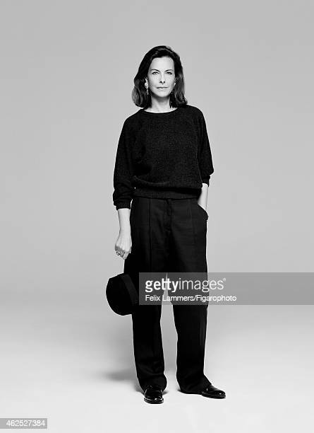 Actress Carole Bouquet is photographed for Madame Figaro on December 22 2014 in Paris France Pullover pants hat earrings and ring shoes CREDIT MUST...