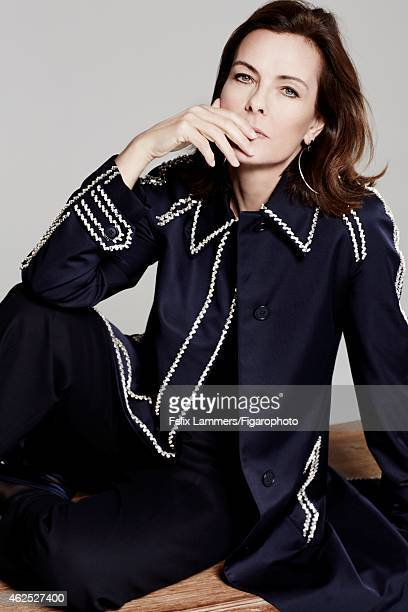 Actress Carole Bouquet is photographed for Madame Figaro on December 22 2014 in Paris France Coat and pants tshirt earings mocassins CREDIT MUST READ...