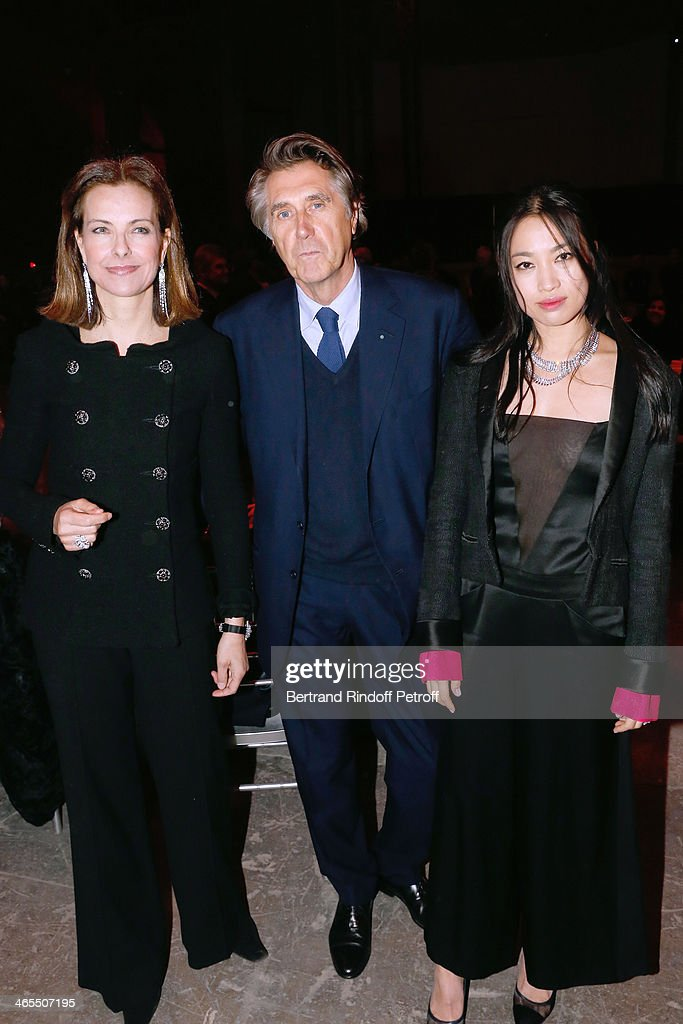 Actress Carole Bouquet , singer Bryan Ferry and Yi Zhou attend the 'Nuit De La Chine' - Opening Night at Grand Palais on January 27, 2014 in Paris, France.