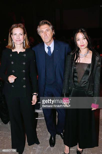 Actress Carole Bouquet singer Bryan Ferry and Yi Zhou attend the 'Nuit De La Chine' Opening Night at Grand Palais on January 27 2014 in Paris France
