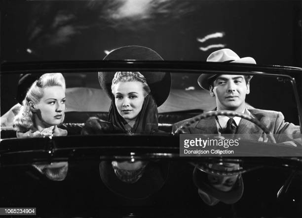 Actress Carole Landis Betty Grable and Victor Mature in a scene from the movie I Wake Up Screaming