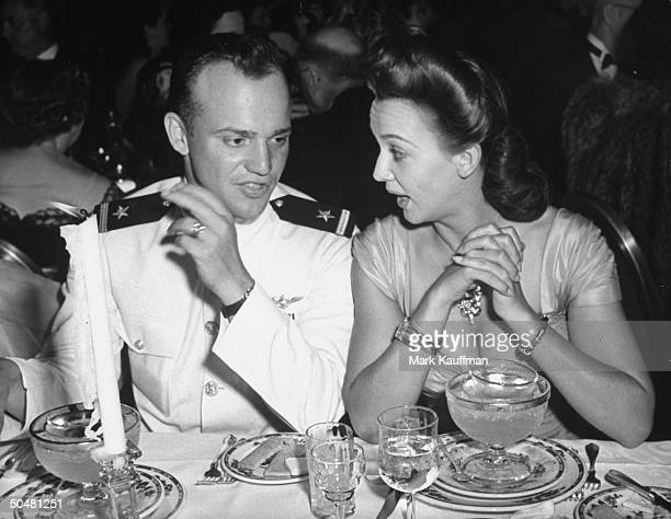 Actress Carole Landis talking with Ens Francis Pinter at a party for war heroes hosted by movie actresses