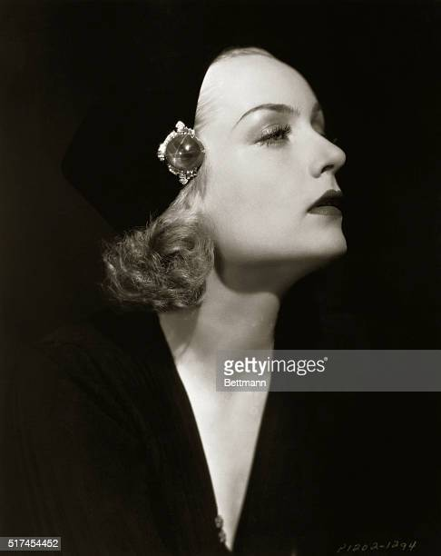 Actress Carole Lombard one of Hollywood's most popular blondes is seen in a beautiful closeup profile portrait This dramatic black and white portrait...