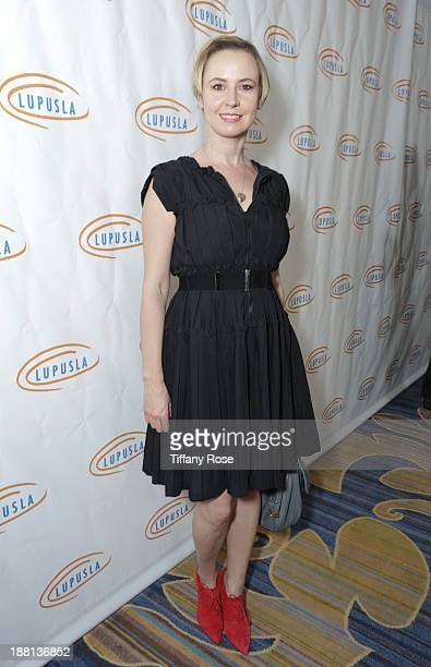 Actress Caroline Carver attends the Hollywood Bag Ladies Luncheon on November 15, 2013 in Beverly Hills, California.