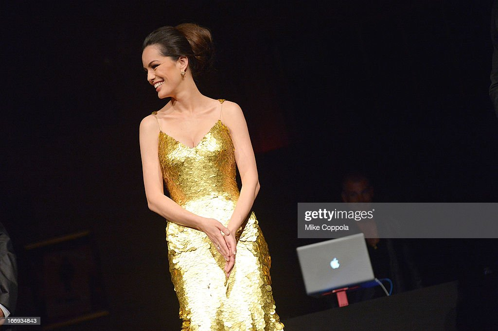 Actress Caroline Correa debuts the 24-k gold dress featured in the 'As Good As Gold' MAGNUM Gold?! Film Premiere on April 18, 2013 in New York City.
