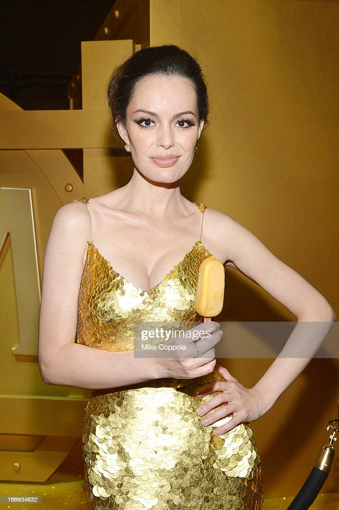 Actress Caroline Correa poses with a MAGNUM Gold?! bar at the 'As Good As Gold' MAGNUM Gold?! Film Premiere on April 18, 2013 in New York City.