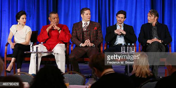 Actress Caroline Dhavernas actor Laurence Fishburne executive producer Bryan Fuller actor Hugh Dancy and actor Mads Mikkelsen of the television show...