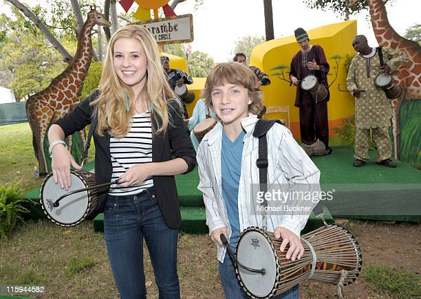 Actress Caroline Sunshine and actor Jake Short play in the Harambe Drum Circle during the 22nd Annual Time for Heroes Celebrity Picnic sponsored by...