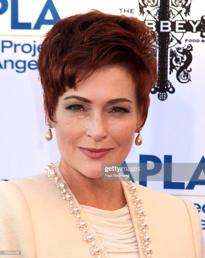 Actress Carolyn Hennesy arrives at APLA and The Abbey's 12th Annual 'The Envelope Please' Oscar Viewing Party at The Abbey on February 20, 2013 in West Hollwwod, California.