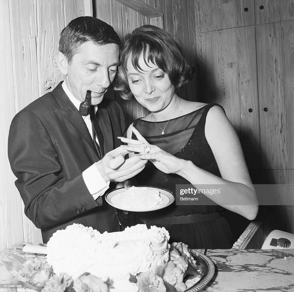 Actress Carolyn Jones, seen here with her husband, producer Aaron Spelling, was surprised twice when friends helped the pair celebrate their 10th wedding anniversary. Besides a surprise party the actress was startled to find a five-carat diamond ring - a gift from Spelling - adorning the top of the 10th anniversary wedding cake!