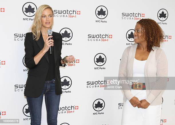 Actress Carolyn Murphy and Annika Holder Asst Commissioner of NYC Parks Department speak during Swatch Scuba Libre Days Launch at Chelsea Recreation...