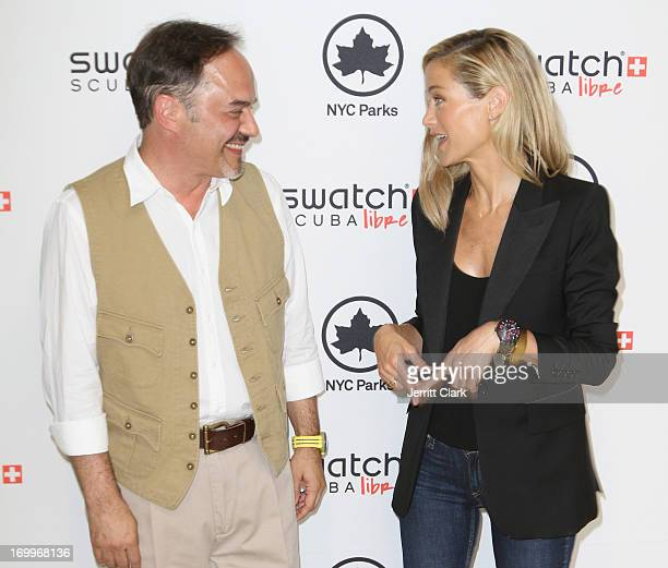 Actress Carolyn Murphy and Frank Furlan President/CEO at The Swatch Group USA pose during Swatch Scuba Libre Days Launch at Chelsea Recreation Center...