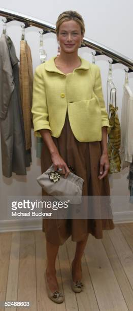 Actress Carolyn Murphy poses at the grand opening of Marni's Los Angeles Boutique on March 22, 2005 in Los Angeles, California.