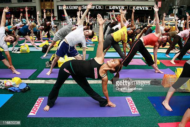Actress Carrie Ann Inaba attends the Times Square Alliance summer solstice yogathon on June 21 2008 at Military Island in Times Square in New York