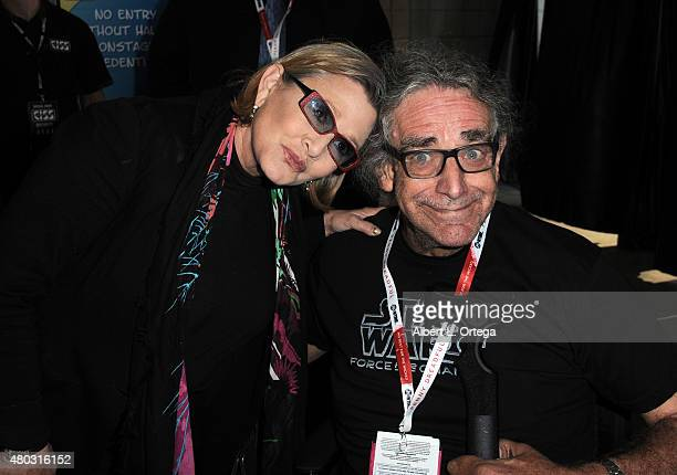 Actress Carrie Fisher and actor Peter Mayhew pose backstage at the Lucasfilm panel during ComicCon International 2015 at the San Diego Convention...