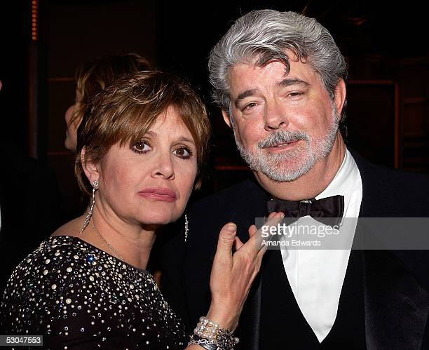Actress Carrie Fisher and director George Lucas pose at the dinner during the 33rd AFI Life Achievement Award tribute to George Lucas at the Kodak...