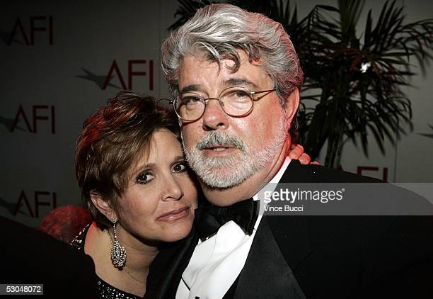 Actress Carrie Fisher and director George Lucas pose together at the 33rd AFI Life Achievement Award after party at the Highlands on June 9 2005 in...