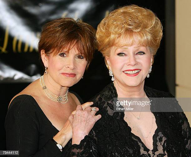 Actress Carrie Fisher and her mother actress Debbie Reynolds arrive for Dame Elizabeth Taylor's 75th birthday party at the RitzCarlton Lake Las Vegas...