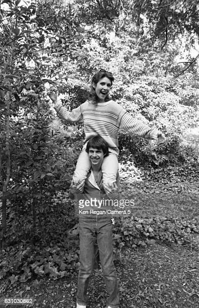 Actress Carrie Fisher is photographed with brother Todd Fisher in 1983 at home in Los Angeles California CREDIT MUST READ Ken Regan/Camera 5 via...