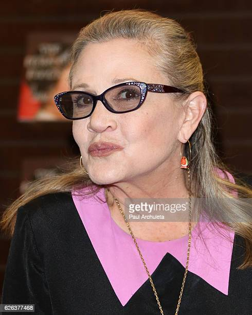 Actress Carrie Fisher signs copies of her new book 'The Princess Diarist' at Barnes Noble at The Grove on November 28 2016 in Los Angeles California