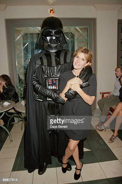 Actress Carrie Fisher with an actor in a Darth Vader costume at a 'Star Wars Extravaganza' held at Alexandra Palace in London 12th October 1995