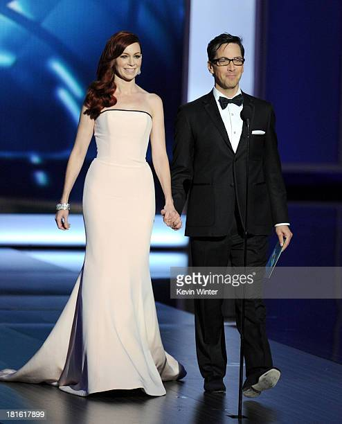 Actress Carrie Preston and actor Dan Bucatinsky walk onstage during the 65th Annual Primetime Emmy Awards held at Nokia Theatre LA Live on September...