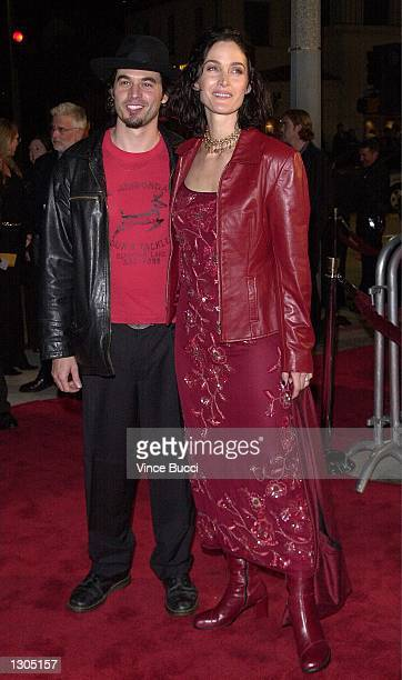 "Actress Carrie-Ann Moss and husband actor Steven Roy arrive at the premiere of ""Red Planet"" on November 6, 2000 in Westwood, CA."
