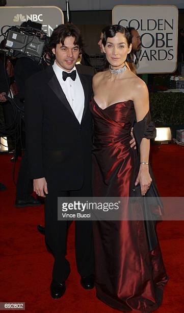 Actress CarrieAnne Moss and her husband Steve Roy attend the 59th Annual Golden Globe Awards at the Beverly Hilton Hotel January 20 2002 in Beverly...