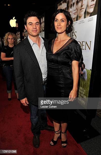 "Actress Carrie-Anne Moss and husband Steven Roy arrive at ""Fireflies In The Garden"" premiere at the Pacific Theater at the Grove on October 12, 2011..."
