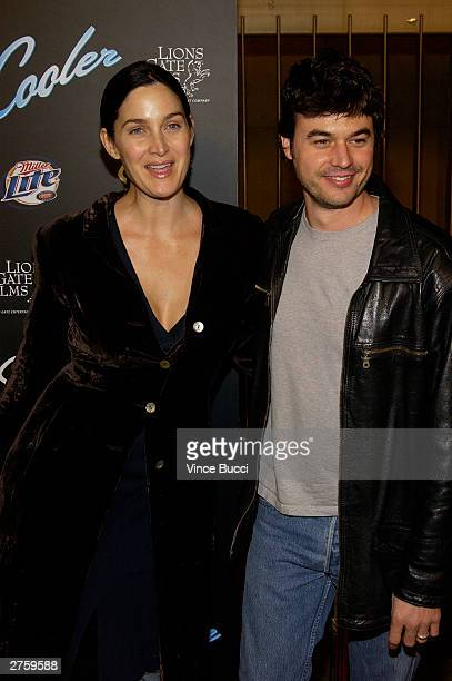Actress CarrieAnne Moss and husband Steven Roy attend the premiere of The Cooler held on November 24 2003 at the Egyptian Theater in Los Angeles...