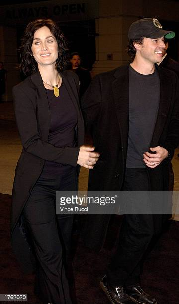 Actress CarrieAnne Moss and husband Steven Roy attend the screening of the short animated film Final Flight of the Osiris and the debut of the video...