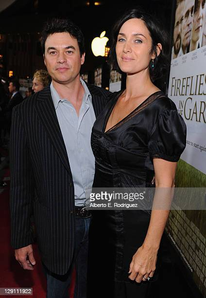 "Actress Carrie-Anne Moss and Steven Roy arrive at the ""Fireflies In The Garden"" Premiere at Pacific Theaters at the Grove on October 12, 2011 in Los..."