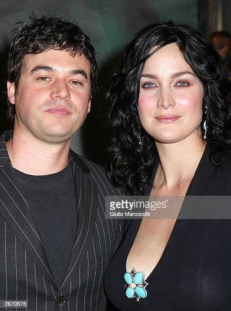 "Actress Carrie-Anne Moss and Steven Roy attend the film premiere of ""Matrix Revolution"" at the Disney Hall on October 27, 2003 in Los Angeles,..."