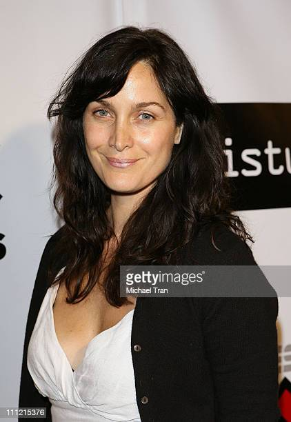 Actress CarrieAnne Moss arrives at the Disturbia DVD release party at The Standard Hotel on August 2 2007 in Los Angeles California