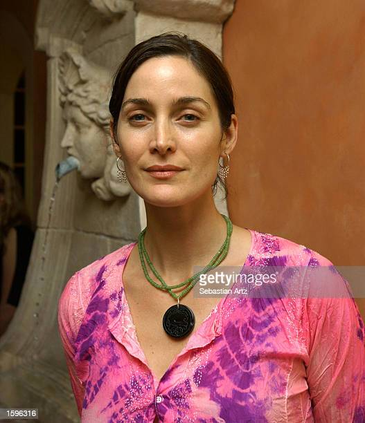 Actress CarrieAnne Moss attends 'Lend A Hand' an exclusive night of Beauty Jewelry and Fun at Frederic Fekkai Salon on November 6 2002 in Beverly...